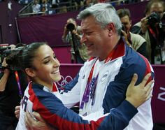 Gymnastics: Event Finals -Alexandria Raisman with her coach after performing balance beam final - Day 11 of the 2012 London Olympics