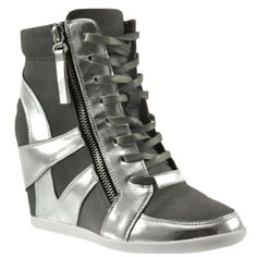 Boast the sportswear trend with this street chic wedge sneaker featuring a lace-up construction, side zipper accent, color blocked upper, inside zip closure and discreet wedged heel.
