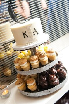 Mixed Cupcake Tower and Cutting Cake from Retro Bakery Las Vegas at this Modern MGM Grand Skyline Terrace Suite Wedding from Tyler Freear Photography // Featured on Little Vegas Wedding