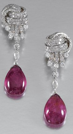 https://www.bkgjewelry.com/ruby-rings/109-18k-yellow-gold-diamond-ruby-ring.html PAIR OF PENDENT RUBELLITE AND DIAMOND EARRINGS Each suspending a cabochon rubellite drop from a marquise-shaped diamond, to a stylised knot surmount set with brilliant-cut stones, post and clip fittings.