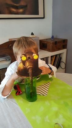 Robot-pictures attached to straws to serve as masks