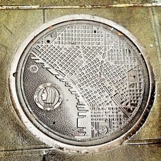 Seattle Washington manhole cover map of downtown.... when Seattle first became incorporated natives were not allowed in the city limits :(