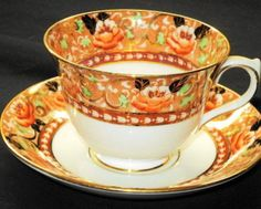 ROYAL ALBERT COBALT BLUE GOLD RUST ORANGE ROSES Crown china TEA CUP AND SAUCER