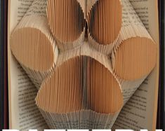 Book Folding Pattern Large Paw Print by BookFoldingAustralia Old Book Crafts, Book Page Crafts, Paper Crafts, Folded Book Art, Paper Book, Book Folding Patterns Free Templates, Templates Free, Book Sculpture, Paper Sculptures