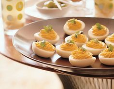 Chipotle Deviled Eggs?! Yes! Link to recipe from epicurious: http://www.epicurious.com/recipes/food/views/Chipotle-Deviled-Eggs-236167