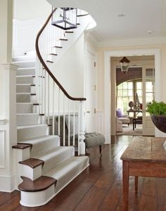 A stunning curved staircase is one of many traditional elements in this home