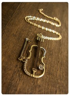 This gorgeous violin necklace ($37).very cute | 32 Impossibly Cute Pieces Of Jewelry For Music Lovers