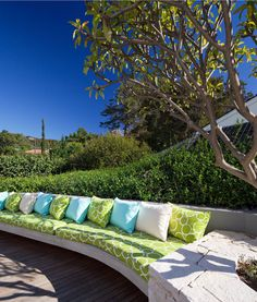 built-in patio seating with colorful custom cushions