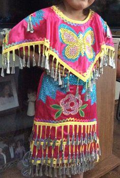 Jingle dress with detachable apron and cape. By Pita Macias