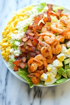 Shrimp Cobb Salad - A light, filling salad loaded with roasted shrimp, bacon bits, and avocado in a tangy, refreshing vinaigrette!