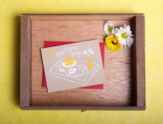 Breakfast in bed is the classic Mother's Day treat. Imagine your mom or mother of your children reading this card as she enjoys breakfast in bed! If you can't prepare the breakfast, this card's cheery spread of sunny side up, toast, coffee and darling daisies will definitely brighten any mothers' mailbox! | Mother's Day Breakfast in Bed card by ShiftingStatusKuo on Etsy, $4.25