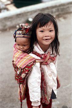 Babywearing photo - siblings in Hong Kong. Love that sweet smile!!!!