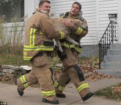 Firemen rescuing a dog from house fire!