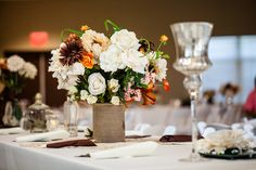 Is that burlap covering the vases?  Pretty.  vintage chic fall wedding table Vintage Chic Fall Wedding by J+A Photography