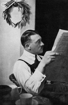Adolf Hitler Reading Newspaper in Landsberg Prison - 42-19420434 - Rights Managed - Stock Photo - Corbis