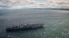 The aircraft carrier USS George Washington (CVN 73) transits the Strait of Magellan.