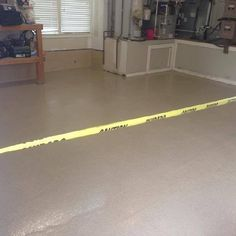 Rhino Linings of Ocean County. This photo shows the garage floor that we applied Rhino HomePro in the color Sandstone.