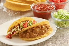 Cheesy seasoned ground beef is served in warm taco shells topped with lettuce, tomato and salsa for an easy, family-pleasing entree.