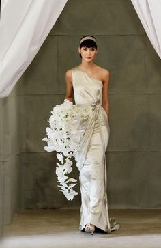 Shine down the aisle in this one-shoulder dress by Carolina Herrera