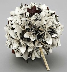 I LOVE ---- The Bouquet:    This idea saves hundreds on flowers...again, providing you dont mind destroying a few copies of a Harry Potter novel. These flowers are made of pages from the books, which means you can literally carry Harry, Ron, Hermione, and the whole Hogwarts gang down the aisle with you...