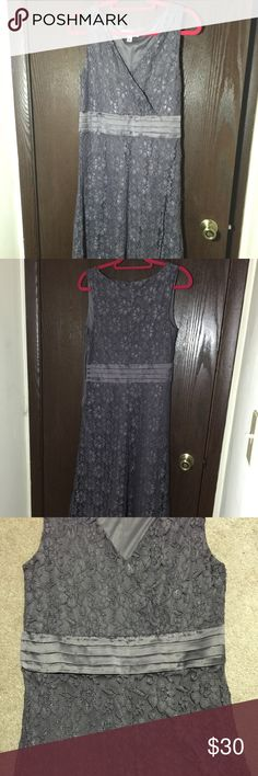 Beautiful Net Dress from 'Isaac Mizrahi' / reduced Gorgeous long sleeveless Net / Lace dress with satin belt design from 'Isaac Mizrahi'                                                           Size is Medium / length is 45 inches   Shiny grayish color / zipper on side, beautiful n elegant piece, perfect for any occasion   Brand New without  tag / Guarantee, u will love it ! Isaac Mizrahi Dresses Midi