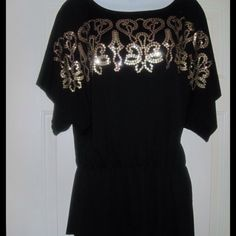 Black Sequined Dolman Sleeved Top Sz 1X Black sequined top by Roman Fashion has dolman sleeves & elastic at the waist  Tags says size 3x but it fits more like a 1X. Material is polyester, rayon, spandex blend. Super soft & comfy!  New with tags! Roman Clothing Tops