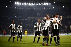 Juventus' forward Gonzalo Higuain from Argentina (2ndR) celebrates with teammates after scoring during the UEFA Champions League football match Juventus Vs GNK Dinamo Zagreb on December 7, 2016 at the 'Juventus Stadium' in Turin.  / AFP / MARCO BERTORELLO
