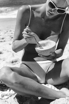 FOR THE HONEYMOON || White bikini, cat eye shades & fresh fruit at the beach || NOVELA...where the modern romantics play & plan the most stylish weddings...Instagram: @novelabride www.novelabride.com