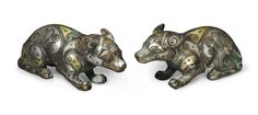 A pair of small gold and silver-inlaid bronze animals, China, Warring States period or later