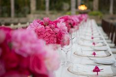 Hot pink low centerpieces for long tables we designed at Club 96 in Los Cabos, Mexico. Photo by Lauren Ross Photography. #elenadamy #floraldesign #hotpinkflowers #loscabos #caboweddings #destinationweddings