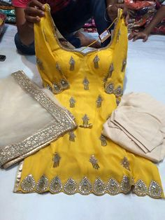 Yellow silver white salwar suit