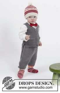 """Goofy Gavin - Set consists of: Knitted DROPS vest with pockets and V-neck in """"Baby Merino"""", knee pants in stocking st in """"Baby Merino"""" and knitted hat and socks with Norwegian pattern in """"Fabel"""" and bow in garter st in """"Fabel"""". SIZE 1 months - 6 years. - Free pattern by DROPS Design"""