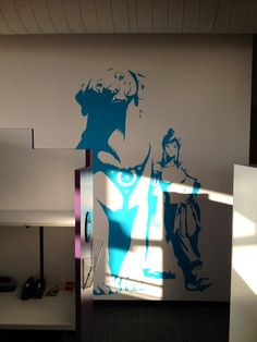 """""""We put together some artwork for these giant decals to decorate our two production areas in the Burbank studio. My favorite is this life-size one of Naga & Korra. That's the same look my dog gives me 90% of the time, and now I can see it towering over the cubicles every time I step outside my office."""" Bryan Konietzko"""