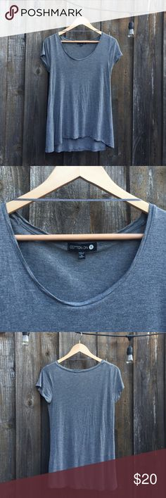 Grey Top Cut tag but still has cleaning instructions.                                Flows nicely, loose appearance.                            Tuck into jeans or pair with leggings!                       No flaws, just like new! Cotton On Tops Tees - Short Sleeve