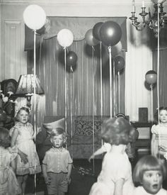 Wonderful! Kensington Children's Party. c. 1934 by genius Bill Brandt (at MoMA).