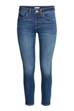 Skinny Low Ankle Jeans: 5-pocket, low-rise ankle-length jeans in washed stretch denim with skinny legs with a concealed zip at the hems.