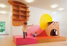 Kita Hisa designed by Baukind in Berlin. Ramps, platforms, varying levels and internal play structures invite play.