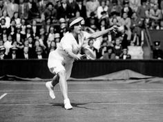 Helen Wills dives for the return during the 1927 Wimbledon tennis tournament.  She emerged the champion that year.