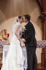Special Moment. First Kiss. Beautiful Bride. Real Bride Wedding Dress from the David's Bridal Collection. Catholic Wedding Ceremony at St. Patrick's Catholic Church in Denison, TX. Wedding Photography by LightRing Productions - lightringpro.com