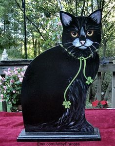 Frances, the Irish woman living in the U.S. who painted this pretty kitty, needs to make some more!!!  (Seen at: http://catwisdom101.com/tag/etsy-com-cat-art-st-patricks-day/)