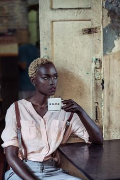 eshusplayground:  Actual Black Elf (most likely Sinda given the use of hair dye and moderate jewelry) sipping coffee or tea. This Elf is dressed comfortably. Where are they going? Where have they been? What is thir story?(Please do not reblog this to drool over the pic. This is about finding people of color who can easily portray Elves.)
