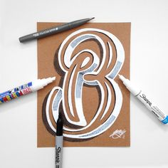 A collection of hand drawn typography on kraft paper