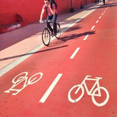 Red bicycle paths in Copenhagen (Denmark, bike, lanes, København, travel, Europe, Nørrebro, Superkilen, red square) http://www.visitcopenhagen.com/copenhagen/bike-city