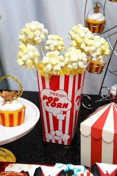 Don't miss this fun circus birthday party at CatchMyParty.com! The marshmallow popcorn cake pops are excellent!  #catchmyparty #partyideas #circus #circusparty #boybirthdayparty #thegreatestshowman #popcorn #cakepops