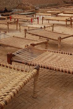 Charpoys laid out for marriage procession. Pakistan // Shaukat Niazi