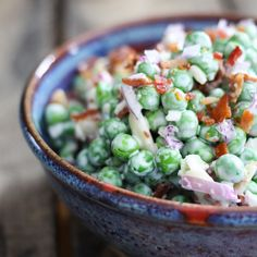 Easy Bacon Pea Salad: It doesn't get much easier or tastier than this cold salad of peas, crispy bacon, crunchy red onions, and creamy dressing. Serve with grilled or roasted chicken, pork, fish, or even ham!