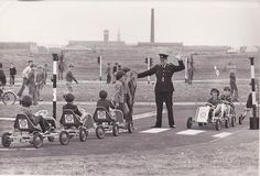 """Garda Ray Campion hosts another traffic schooling for school children. Dublin Street, Dublin City, Old Pictures, Old Photos, Images Of Ireland, Irish People, Photo Engraving, Dublin Ireland, Us Travel"