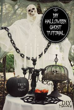 Link to a tutorial on the ghost, but I'm loving the skull inside the cake stand/cage thing on the table.