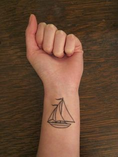 sailboat wrist tattoo black line