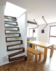 Stairs are so common that you don't give them a second thought. Check out examples of modern staircase that are as stunning as they are creative. Architecture Design, Architecture Renovation, Space Saving Staircase, Escalier Design, Steps Design, Modern Stairs, House Stairs, Attic Stairs, Loft Staircase